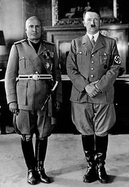 Mussolini and Hitler standing side by side.