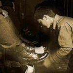 shoeshine boy shining a pair of shoes