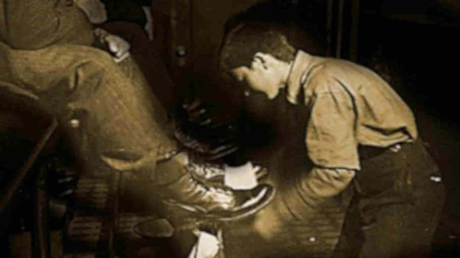shoeshine boy shining a pair of shoes